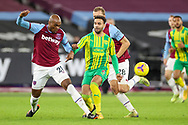 Angelo Ogbonna (21) of West Ham United battles with Hal Robson-Kanu (4) of West Bromwich Albion during the Premier League match between West Ham United and West Bromwich Albion at the London Stadium, London, England on 19 January 2021.