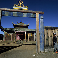 MONGOLIA, Darhad Valley. Children from Rinchenlhumbe lounge outside only Tibetan Buddhist temple in region, built after Russians left Mongolia.