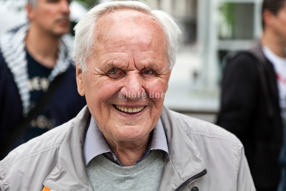 happy and smiling portrait of elderly man