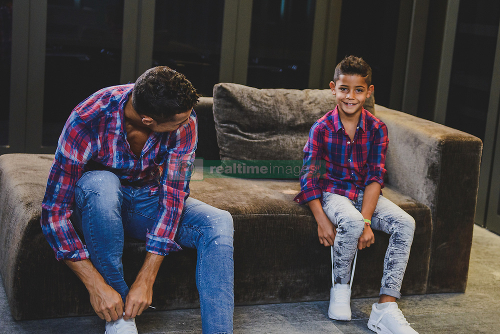 "Cristiano Ronaldo and his mini-me are two peas in a pod in this very cute photoshoot for the football star's new CR7 Junior denim line. The 32-year-old Real Madrid player and his seven-year-old son, Cristiano Ronaldo Jr, pose up a storm, flexing their muscles while shirtless and donning matching outfits. The CR7 Junior collection is available exclusively on CR7.com and markets itself as the ""future of denim"" with ""unrivaled mobility"". Speaking about the new line, Ronaldo explained: ""For me, the CR7 Junior collection is all about having fun and being free, being creative and confident. ""The stretch denim we have used in the collection is extremely comfortable due to the technical elements in the fabric, which will allow boys to run around and be active, move freely and most importantly, play."" Ronaldo — who is also father to four-month-old twins Mateo and Eva Maria and whose girlfriend Georgina Rodriguez is pregnant with his fourth child — went on: ""This is why we have used the PRESS PLAY tagline for the brand. ""I believe the youth of today are the ones driving the society forward in so many ways and I felt that creating a denim collection with my son would celebrate this."". 14 Nov 2017 Pictured: Cristiano Ronaldo and his son Cristiano Ronaldo Jr. pose together in a photoshoot for the Real Madrid star's new CR7 Junior denim line. Photo credit: CR7/ MEGA TheMegaAgency.com +1 888 505 6342"