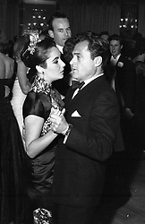 ELIZABETH TAYLOR and MIKE TODD at a ball in London on 21st January 1958.
