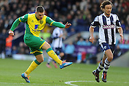 Gary Hooper of Norwich city shoots and scores his sides 1st goal. Barclays Premier league, West Bromwich Albion v Norwich city at the Hawthorns in West Bromwich, England on Sat 7th Dec 2013. pic by Andrew Orchard, Andrew Orchard sports photography.