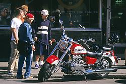 Kids Admiring At Motorcycle