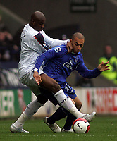Photo: Paul Thomas.<br /> Bolton Wanderers v Everton. The Barclays Premiership. 09/04/2007.<br /> <br /> James Vaughan (Blue) of Everton battles with Abdoulaye Meite.