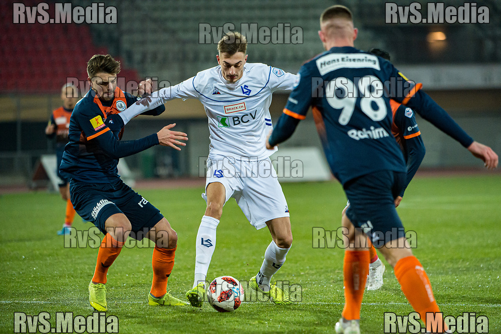 LAUSANNE, SWITZERLAND - NOVEMBER 22: #99 Aldin Turkes of FC Lausanne-Sport battles for the ball with #98 Fuad Rahimi of FC Wil during the Challenge League game between FC Lausanne-Sport and FC Wil at Stade Olympique de la Pontaise on November 22, 2019 in Lausanne, Switzerland. (Photo by Robert Hradil/RvS.Media)