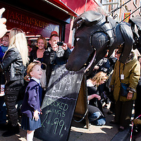 LIVERPOOL, UK, 20th April, 2012. The Sea Odyssey. Xolo, the giant dog, makes some friends at a butchers in Everton.