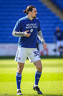 Cardiff City's Ciaron Brown (30) in action during the pre-match warm-up wearing a T shirt supporting Sol Bamba before the EFL Sky Bet Championship match between Cardiff City and Nottingham Forest at the Cardiff City Stadium, Cardiff, Wales on 2 April 2021.