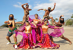 """South Africa - Durban - 22 September 2020 - Dancers Jerusha Singh,  Yuvika Maharaj, Tiasha Singh from Rudra dance threatre based in Durban. It is an Indian dance company that aims to captivate audiences with traditional, contemporary and classical Indian dance. Lead singers from Mzansi Arts Development Ensemble's hit single """"We Shall Over Come"""" Sindisiwe Thusi and Sboniso Mbhele who are part of eMjondolo Arts in Action which looks at the social impact of Covid - 19 on artists living in informal settlements in Durban, told through music and art. Tyrique Williams and Courtney Walljee from the Wentworth Arts and Culture organisation that deals in development of arts and culture with youth and artists in dance, drama and music, were posing outside Moses MAabhida Stadium in Durban in commemoration of the Heritage day on the 24th of September<br /> Picture: Doctor Ngcobo/African News Agency(ANA)"""