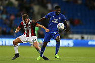 Bruno Ecuele Manga of Cardiff city ® holds off Ched Evans of Sheffield United (l). EFL Skybet championship match, Cardiff city v Sheffield Utd at the Cardiff City Stadium in Cardiff, South Wales on Tuesday 15th August 2017.<br /> pic by Andrew Orchard, Andrew Orchard sports photography.
