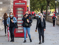 © Licensed to London News Pictures. 01/10/2020. London, UK. Members of the public wear masks while out shopping in Westminster as more Covid lockdown restrictions come into force for the North East of England and Liverpool as cases of coronavirus continue to rise throughout the UK. Photo credit: Alex Lentati/LNP