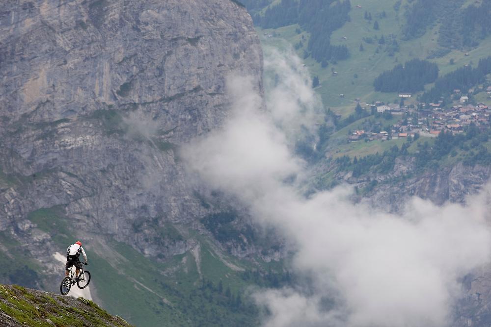 Copyright: outdoorgames.org / Christophe Margot.Event: Nissan Outdoor Games, Interlaken 2008.Photographer: Christophe Margot.Date: 3 July 2008.Athlete: Rene /Team IBEX .Description:Action MTB near the Eigergletscher Train Station/Team IBEX