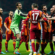 Referee's Huseyin Gocek (R) and Galatasaray's Burak Yilmaz (F) during their Turkish Super League soccer match Galatasaray between Kasimpasaspor at the TT Arena at Seyrantepe in Istanbul Turkey on Friday, 31 October 2014. Photo by Kurtulus YILMAZ/TURKPIX