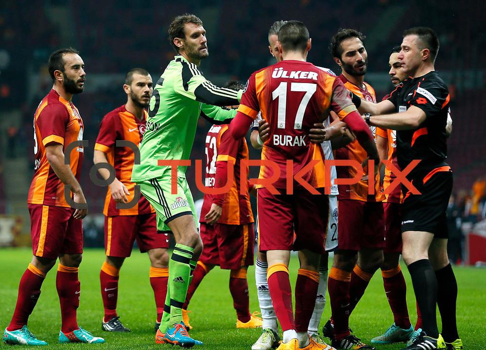 Referee's Huseyin Gocek (R) and Galatasaray's Burak Yilmaz (F) during their Turkish Super League soccer match Galatasaray between Kasimpasaspor at the TT Arena at Seyrantepe in Istanbul Turkey on Friday, 31 October 2014. Photo by Kurtulus YILMAZ/TURKPIX