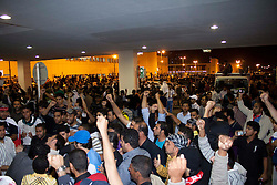 © under license to London News Pictures.  18/02/2011. The scene outside Salmnya Heath Complex in Manama, Bahrain as people are brought in to be treated after being shot by the police. Photo credit should read Michael Graae/London News Pictures