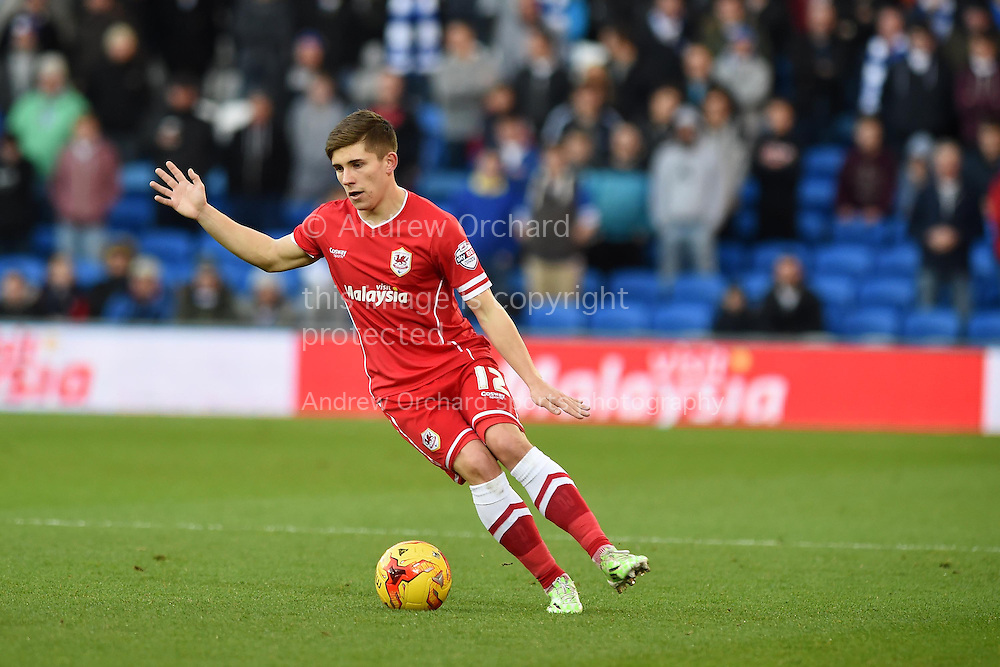 Declan John of Cardiff city in action.Skybet football league championship match, Cardiff city v Watford at the Cardiff city stadium in Cardiff, South Wales on Sunday 28th December 2014<br /> pic by Andrew Orchard, Andrew Orchard sports photography.