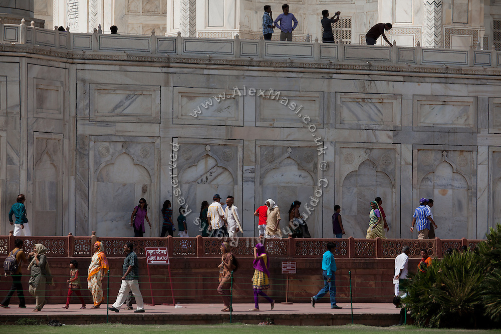 Visitors are walking inside the Taj Mahal complex, in Agra.