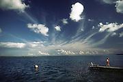 Jack Menzel on the dock at Laguna de Bacalar. Yucatan, Mexico.