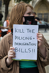 London, UK. 5th July, 2021. An activist holds a sign at a Kill The Bill protest in Parliament Square against the Police, Crime, Sentencing and Courts (PCSC) Bill 2021 as MPs consider amendments to the Bill in the House of Commons. The PCSC Bill would grant the police a range of new discretionary powers to shut down protests.