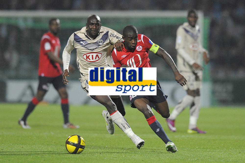 FOOTBALL - FRENCH CHAMPIONSHIP 2010/2011 - L1 - LILLE OSC v GIRONDINS BORDEAUX  - 16/04/2011 - PHOTO JEAN MARIE HERVIO / DPPI - RIO MAVUBA (LOSC) / ALOU DIARRA (GDB)
