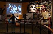 Ben Physick of Austrailia watches the life of Muhammad Ali in video clips on display Thursday, Jan. 11, 2012 at the Muhammad Ali Center in Louisville, Ky. (AP Photo/Brian Bohannon)