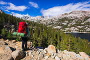 Backpacker above South Lake, John Muir Wilderness, Sierra Nevada Mountains, California USA