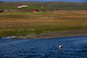 Fishing in the river in Stora Laxa, one of Iceland's better haunts for extra large salmon, with a few of 20 pounds plus caught each season