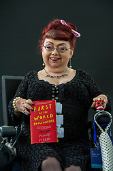 Pictured: Penny Pepper is a genre-defying writer and well-known rights activist. She wrote the taboo-breaking book Desires Reborn in 2012, and in 2013 she won a Creative Futures Literary Award. In 2014 her one-woman spoken word show, Lost in Spaces, premiered to strong reviews at Soho Theatre.<br /> <br /> Book fanatics headed to Charlotte Square in Edinburgh which is the hub of the international Book Festival to meet the authors and also to meet up with fellow fans of the printed word.<br /> <br /> <br /> Ger Harley | EEm 18 August 2017