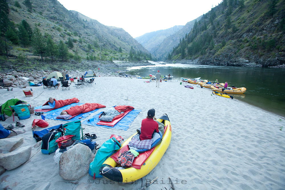 A woman looks out at camp along the Salmon River.