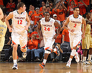Jan. 22, 2011; Charlottesville, VA, USA; Virginia Cavaliers guard Joe Harris (12), Virginia Cavaliers guard K.T. Harrell (24) and Virginia Cavaliers guard Mustapha Farrakhan (2) reacts to a play during the game after the game at the John Paul Jones Arena. Mandatory Credit: Andrew Shurtleff-US PRESSWIRE