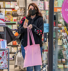 © Licensed to London News Pictures. 02/03/2020. London, UK. A young women does some shopping at Victoria Station in a protective mask as fears of a pandemic increase after 4 new cases of Coronavirus are confirmed in the UK. Photo credit: Alex Lentati/LNP