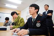 Vice principal Byung-Chul Shin is standing behind the students Kyung bae Kim, Yong mook Kim,  Soo jin Ahn and Ji hoon Park. Shinil High School, Seoul, South Korea.
