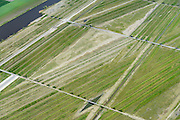 Nederland, Noord-Holland, Hoofddorp, 09-04-2014; Landartpark Buitenschot, de ribbels dienen tevens om geluidsoverlast te verminderen. Bureau H+N+S , kunstenaar Paul de Kort <br /> Landartpark, the ridges also serve to reduce noise.<br /> luchtfoto (toeslag op standard tarieven);<br /> aerial photo (additional fee required);<br /> copyright foto/photo Siebe Swart