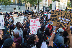 "London, July 8th 2016. Hundreds gather on London's Southbank before marching through the streets of London to Parliament Square, Downing Street and the BBC, in a Black Lives Matter protest in solidarity with Americans following the shooting dead of two black men, Philando Castile in Minnesota and Alton Sterling in Louisiana by police in the US. PICTURED: The crowd chants ""Hands up! Don't Shoot!"" outside the gates of Downing Street."