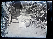 little child with mother in garden France 1920s