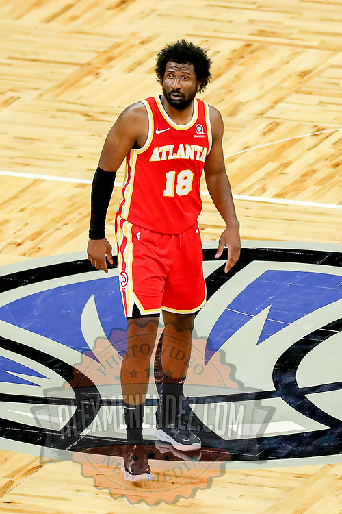 ORLANDO, FL - MARCH 03: Solomon Hill #18 of the Atlanta Hawks plays defense against the Orlando Magic at Amway Center on March 3, 2021 in Orlando, Florida. NOTE TO USER: User expressly acknowledges and agrees that, by downloading and or using this photograph, User is consenting to the terms and conditions of the Getty Images License Agreement. (Photo by Alex Menendez/Getty Images)*** Local Caption *** Solomon Hill