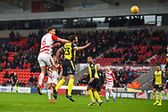 Andrew Butler of Doncaster Rovers (6) rises above Rory McArdle of Scunthorpe United (23) to head the ball during the EFL Sky Bet League 1 match between Doncaster Rovers and Scunthorpe United at the Keepmoat Stadium, Doncaster, England on 15 December 2018.