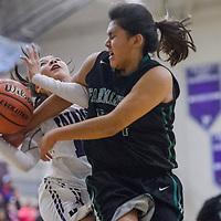 Miyamura Patriot Sarah Gilmore (10) is fouled by Farmington Scorpion Philinda Nez (24) Friday at Miyamura High School.