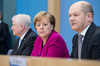 12 MAR 2018, BERLIN/GERMANY:<br /> Horst Seehofer (L), CSU, desig. Bundesinnenminister, Angela Merkel (M), CDU, Bundeskanzlerin, und Olaf Scholz (R), SPD, desig. Bundesfinanzminister, waehrend einer Pressekonferenz zum Koalitionsvertrag der CDU/CSU und SPD, Bundespressekonferenz<br /> IMAGE: 20180312-01-010