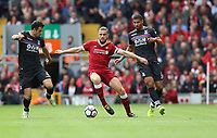 Football - 2017 / 2018 Premier League - Liverpool vs. Crystal Palace<br /> <br /> Jordan Henderson of Liverpool is closed down by Ruben Loftus-Cheel and Scott Dann of Crystal Palace at Anfield.<br /> <br /> COLORSPORT/LYNNE CAMERON
