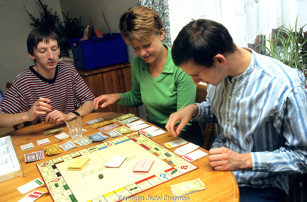 Disabled people playing monopoly
