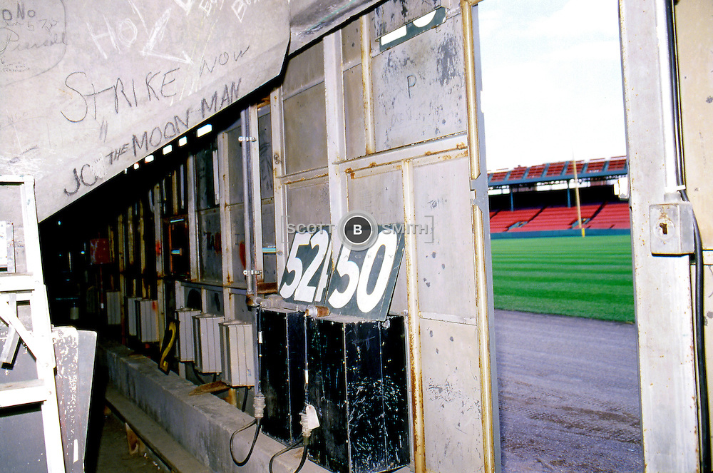 View looking out from behind the green monster left field wall scoreboard in Famous Fenway Park, home to the American League's Boston Red Sox. Opened April 20, 1912