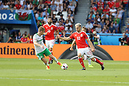 Aaron Ramsey of Wales looks to go past Steven Davis of Northern Ireland. UEFA Euro 2016, last 16 , Wales v Northern Ireland at the Parc des Princes in Paris, France on Saturday 25th June 2016, pic by  Andrew Orchard, Andrew Orchard sports photography.