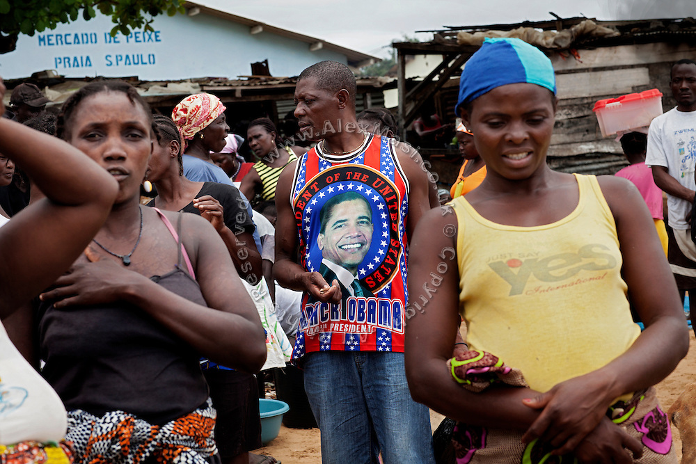 A man is wearing a Barack Obama t-shirt while standing around a fish market in Praia Cruz, on the island of Sao Tome, Sao Tome and Principe, (STP) a former Portuguese colony in the Gulf of Guinea, West Africa.