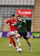 Plymouth Argyle midfielder Conor Grant (15) in action with Crewe Alexandra midfielder Owen Dale (19) during the EFL Sky Bet League 1 match between Plymouth Argyle and Crewe Alexandra at Home Park, Plymouth, England on 16 January 2021.