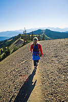 A woman hiking on a trail on Hurricane Ridge in Olympic National Park, Washington State.