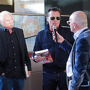 NLD/Amsterdam/20121129- Presentatie Jubileumboek 125 jaar historie Carre, Barry Hay en Cesar Zuiderwijk nemen het boek in ontvangst