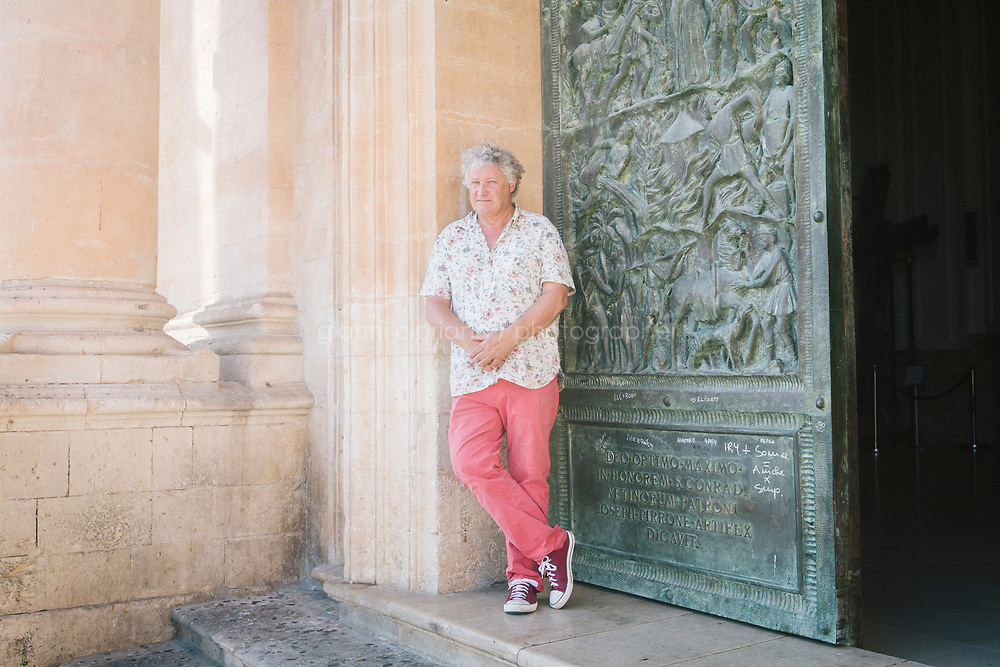 NOTO, ITALY - 19 JULY 2017: Sculptor David Harber poses for a portrait in Noto, Italy, on July 18th 2017.