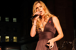 Covent Garden, London, October 30th 2014. Multi-platinum selling artist Joss Stone performs two numbers with legendary guitarist Jeff Beck as part of the events in Covent Garden where London Poppy Day events were held as the Royal British Legion raises funds, with over £1 million expected to be raised. PICTURED: Joss Stone