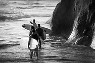 Group of male surfers carrying surfboards heading out to surf at Terramar Surf Beach in Carlsbad, CA. <br /> <br /> THIS IMAGE ALSO AVAILABLE AS SIGNED, LIMITED EDITION PRINT. SERIES LIMITED TO 10. <br /> <br /> EMAIL RR@ROBERTRANDALL.COM FOR PRICING