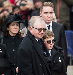 © Licensed to London News Pictures. 31/03/2018. Cambridge, UK. L TO R JANE HAWKING (first wife) ROBERT HAWKING (SON) GRANDSON (Name unknown) TIMOTHY HAWKING (son).  Family watch as at the coffin leaves the funeral of Stephen Hawking at Church of St Mary the Great in Cambridge, Cambridgeshire. Professor Hawking, who was famous for ground-breaking work on singularities and black hole mechanics, suffered from motor neurone disease from the age of 21. He died at his Cambridge home in the morning of 14 March 2018, at the age of 76. Photo credit: Ben Cawthra/LNP